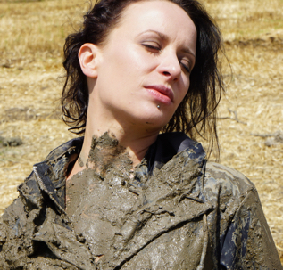 Sonja getting muddy in black raincoat and vinyl shirt (48 pics)